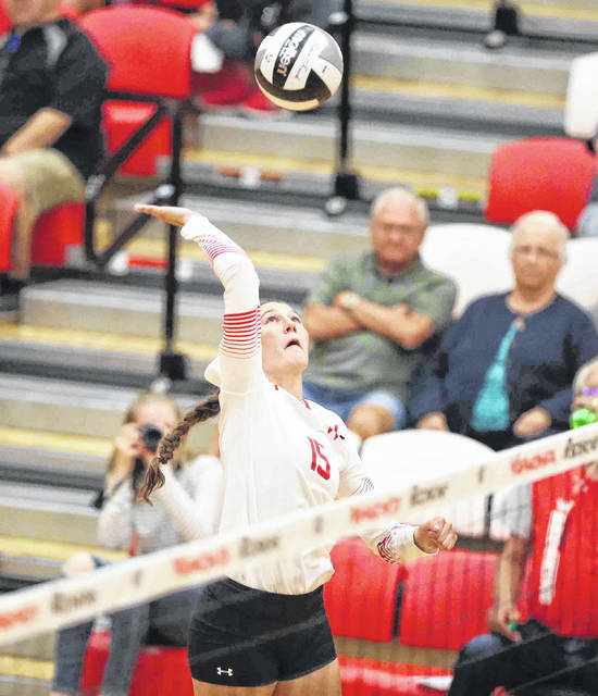 Wapakoneta's Makenzie Wilson eyes the ball while going up for a spike during Thursday night's home match against Van Wert.