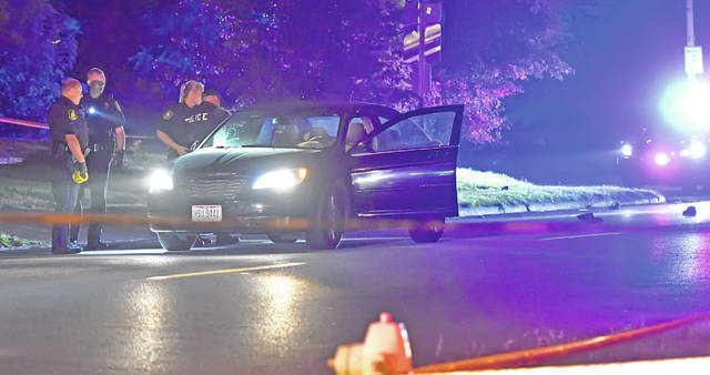 Lima Police Department officers investigate a car hitting a pedestrian late Thursday night in the 500 block of North Jackson Street.