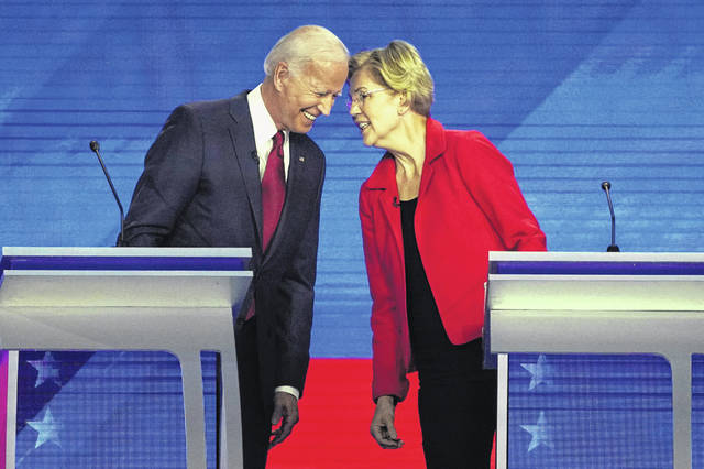 Democratic presidential candidates former Vice President Joe Biden, left and Sen. Elizabeth Warren, D-Mass., talk Thursday during a Democratic presidential primary debate hosted by ABC at Texas Southern University in Houston. (AP Photo/David J. Phillip)