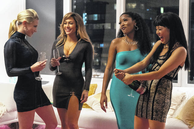 "This image released by STXfilms shows, from left, Lili Reinhart, Jennifer Lopez, Keke Palmer, and Constance Wu in a scene from ""Hustlers,"" in theaters on Sept. 13."