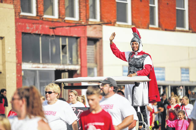 Lima Spartans band and cheerleaders walk the Labor Day parade in downtown Lima on Monday morning.