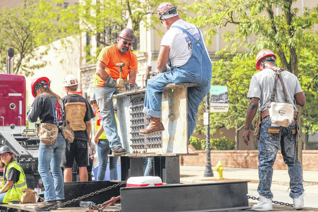 Local 290 Iron Workers of Dayton represent their industry during the Labor Day parade in downtown Lima on Monday morning.