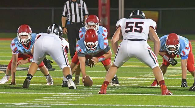 The Lima Central Catholic offense and Spencerville defense finally get on the field following a lightning delay Friday night at Spartan Stadium.  Richard Parrish | The Lima News