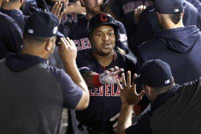 Cleveland's Jose Ramirez is congratulated in the dugout following his three-run home run Tuesdasy night against the White Sox in Chicago. (AP photo)