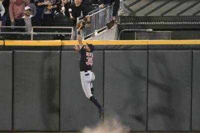 Cleveland's Oscar Mercado is unable to prevent an RBI double by the White Sox's Zack Collins during Thursday night's game in Chicago. (AP photo)
