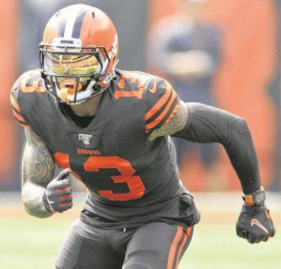 Cleveland Browns wide receiver Odell Beckham Jr. runs a route during the first half in an NFL football game against the Tennessee Titans, Sunday, Sept. 8, 2019, in Cleveland. The flashy, fashionable wide receiver sported an expensive watch, worth over $250,000, during his debut Sunday. The NFL plans to speak with Browns star Odell Beckham Jr. about wearing a watch in games. (AP Photo/Ron Schwane)