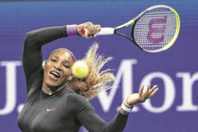 Serena Williams hits a return to Qiang Wang during a Tuesday night US Open quarterfinal in New York.