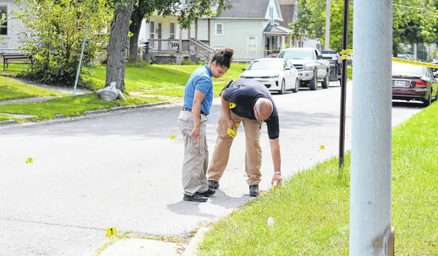 Lima Police investigate a shooting Tuesday afternoon at Elm and Nye Street.