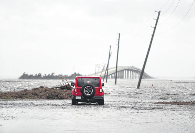 Storm surge from Hurricane Dorian blocks Cedar Island off from the mainland on NC 12 in Atlantic Beach, N.C., after Hurricane Dorian past the coast on Friday.