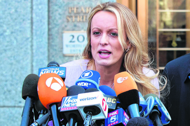 FILE - In this April 16, 2018, file photo, adult film actress Stormy Daniels speaks outside federal court in New York.