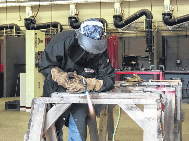 Students at Apollo Career Center learn traditional and robotic welding as the vocational school trains students for an increasingly automated workplace.