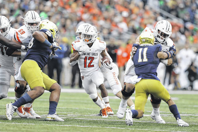 Bowling Green's Bryson Denley (12) looks for yardage during Saturday's game against Notre Dame in South Bend, Ind.