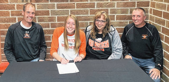 Joining Fort Jennings' Kristen Luersman, second from left, for her signing Tuesday to play basketball at Ohio Northern University were her father, David, left, mother, Kathy, and Musketeers coach Billy Calvelage.