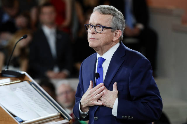 FILE - In this Jan. 14, 2019 file photo, Ohio Governor Mike DeWine speaks during a public inauguration ceremony at the Ohio Statehouse, in Columbus, Ohio. DeWine is ready to share specifics of his plan to curb gun violence through proposed changes expected to face pushback from fellow Republicans who control the Legislature. After a shooter in Dayton killed nine people in August, DeWine advocated requiring background checks for nearly all gun sales and allowing courts to restrict firearms access for people perceived as threats. He was expected to unveil details of his proposal Monday, Oct. 7 joined by Dayton Mayor Nan Whaley, a Democrat. (AP Photo/John Minchillo, Pool)