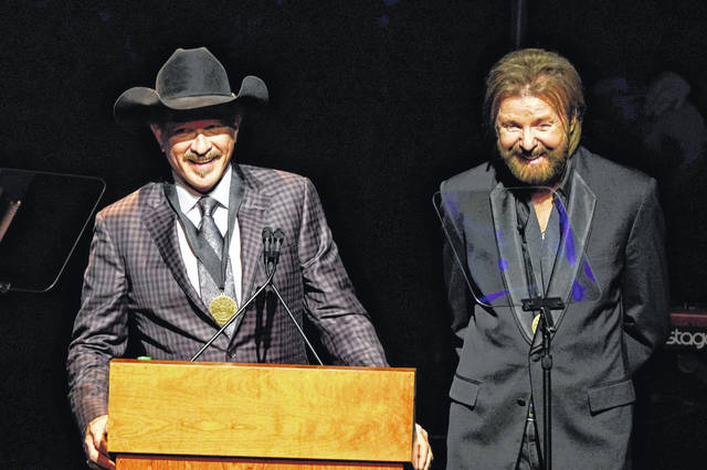 Kix Brooks, left, and Ronnie Dunn, right, speak after being inducted into the Country Music Hall of Fame at the 2019 Medallion Ceremony at the Country Music Hall of Fame and Museum on Sunday in Nashville, Tenn.