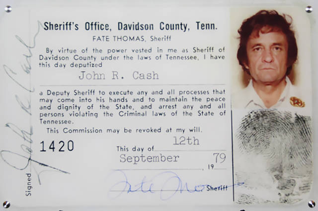 "This 1979 image released by the Davidson County (Tenn.) Sheriff's Office via the Johnny Cash Museum, shows Cash's Deputy Sheriff ID card. This week at the Johnny Cash Museum in Nashville, Tenn., Nashville Sheriff Daron Hall unveiled a blown-up image of the late musician's September 1979 deputy sheriff commission card.  The card authorized Cash to ""execute any and all processes that may come into his hands and to maintain the peace and dignity of the State, and arrest any and all persons violating the Criminal laws of the State of Tennessee.""  (Davidson County Sheriff's Office/the Johnny Cash Museum via AP)"