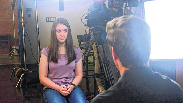 "Payton Leutner, left, is interviewed by ABC's David Muir. Leutner, of Wisconsin, survived a stabbing attack in 2014 by two teenage friends wanting to please a fictional horror character called Slender Man. In her first interview about the attack, which is set to air Friday, Oct. 25, Leutner told ABC News that despite her lingering trauma, she has ""come to accept all of the scars that I have."""