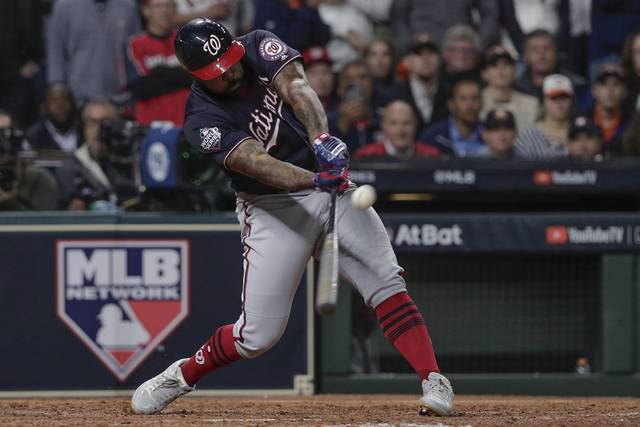 Washington Nationals' Howie Kendrick hits a two-run home run during the seventh inning of Game 7 of the baseball World Series against the Houston Astros Wednesday, Oct. 30, 2019, in Houston. (AP Photo/David J. Phillip)