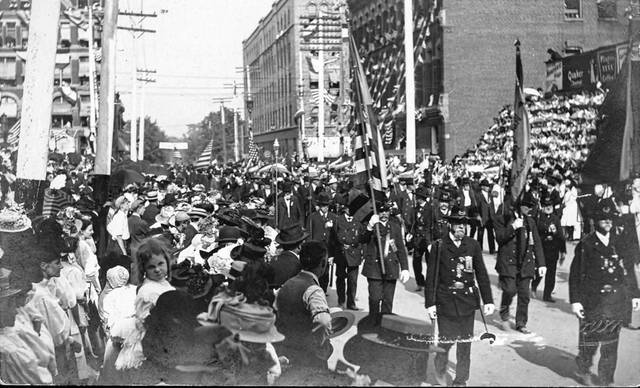 """The Grand Army of the Republic """"Old Guard"""" passes the reviewing stand on the south side of the Allen County Courthouse, progressing west on North Street, during a parade in 1908."""