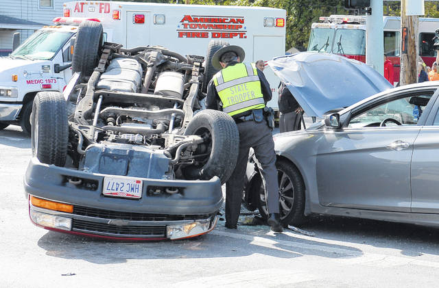 Ohio State Patrol and American Township Fire Department were on the scene of a three-vehicle crash at the intersection of West Robb Avenue and North Cole Street Friday afternoon. Richard Parrish | The Lima News