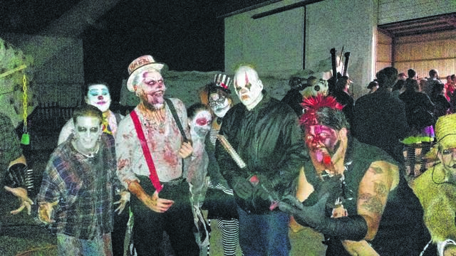 A group of actors at Hammer Brothers Haunted Circus in Waynesfield get into character before going out into the haunted corn maze.