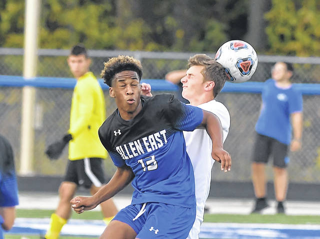 Allen East's Malachi Blackma and Bluffton's Tayton Kleman compete for the ball during Thursday's match at Goodwin Field.