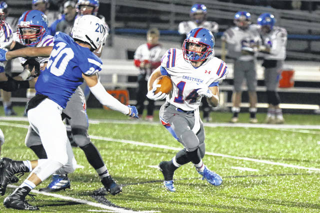 Crestview's Caylib Pruett tries to find his way around Allen East's Chase Miller during Friday night's game at Allen East.