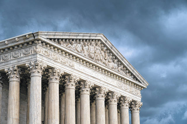 FILE - In this June 20, 2019 file photo, The Supreme Court is seen under stormy skies in Washington. The Supreme Court is adding an abortion case to its busy election-year docket. The justices have agreed to take up a Louisiana law that could leave the state with just one clinic. The justices won't hear arguments until the winter. A decision is likely to come by the end of June.