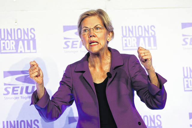 FILE - In this Oct. 4, 2019 file photo, Democratic presidential candidate Sen. Elizabeth Warren, D-Mass., speaks at the SEIU Unions For All Summit in Los Angeles. For 41 years, federal law has banned pregnancy discrimination in the workplace. But the stories tumbling out this week show it's far from eradicated. Prompted by Warren's claim that she was forced out of a teaching job in 1971 because she was pregnant, scores of women have shared similar stories on social media. Police officers, academics, fast food workers, lawyers, flight attendants and others say they hid pregnancies on the job or during interviews, faced demotion or demeaning comments and were even fired after revealing a pregnancy.