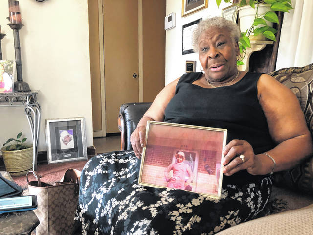 "Minnie Hill holds a photo of her late daughter, Rosie Hill, as she speaks to a reporter in her home on Thursday, Oct. 10, 2019 in Memphis, Tenn. Rosie Hill was found dead in Florida in 1982. In 2018, after Texas authorities began tying Samuel Little to murders around the country, Marion County, Fla., Sheriff's Detective Sgt. Michael Mongeluzzo joined police from several states who flew to a Texas prison, where Little was temporarily being held, in efforts to bring closure for their cold cases. The sheriff's office said ""Little confessed to killing Rosie Hill and dumping her body,"" and even ""told Sgt. Mongeluzzo that he killed Rosie because God put him on this earth to do it."""