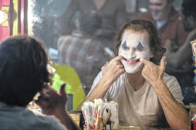 "This image released by Warner Bros. Pictures shows Joaquin Phoenix in a scene from the film ""Joker."""