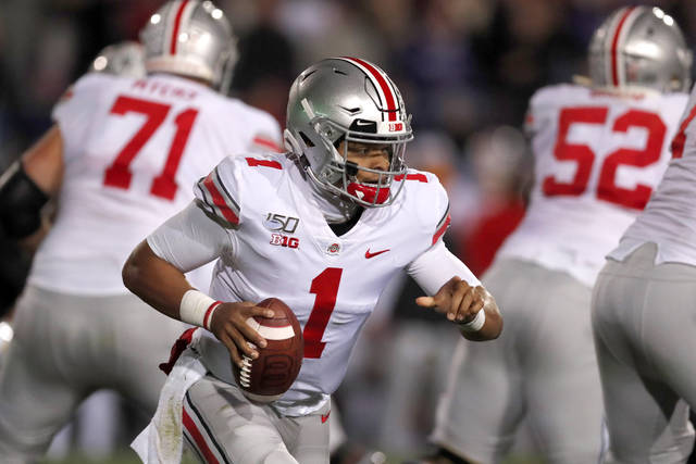 Ohio State quarterback Justin Fields (1) scrambles during the first half of an NCAA college football game against Northwestern, Friday in Evanston, Ill.