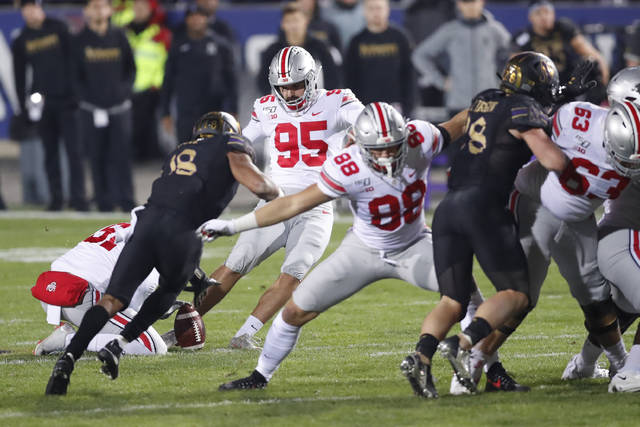 Ohio State placekicker Blake Haubeil (95) boots a 55-yard field goal at the end of the first half of an NCAA college football game against Northwestern in Evanston, Ill.