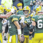 Rodgers tosses 5 TDs, Packers roll