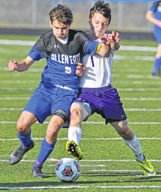 Allen East's Bryce Wilcox, left, competes with Ada's Kyler Stoll during Monday's match at Goodwin Field.