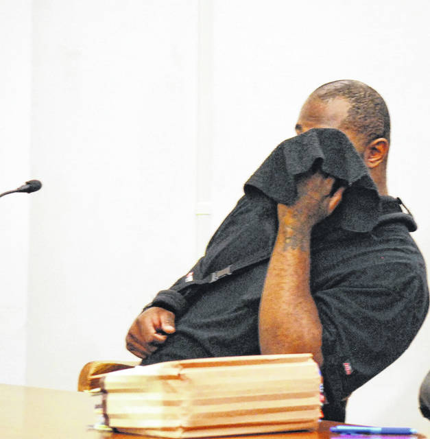 Anthony Davenport used a jacket to hide his face during Tuesday's hearing in Allen County Common Pleas Court.