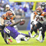Jackson runs, passes Ravens past winless Bengals 23-17