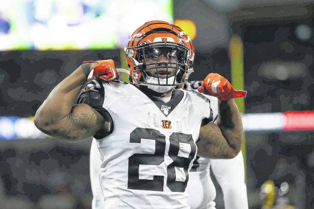 Cincinnati Bengals running back Joe Mixon (28) celebrates after scoring against the Los Angeles Rams during the first half of an NFL football game, Sunday, Oct. 27, 2019, at Wembley Stadium in London. (AP Photo/Tim Ireland)