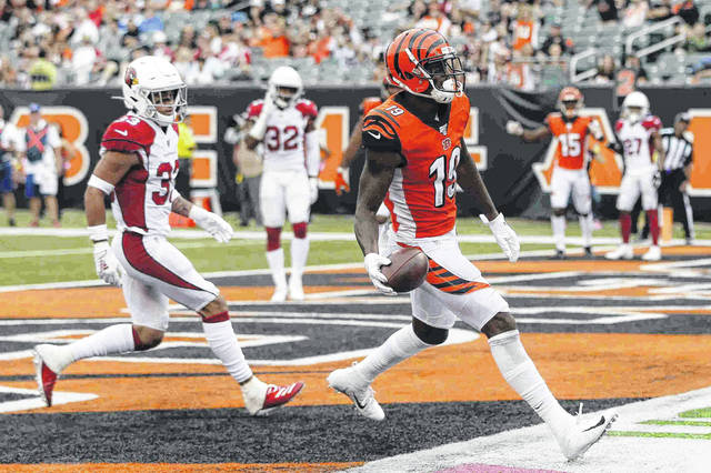 Cincinnati Bengals wide receiver Auden Tate (19) catches a touchdown pass in the second half of an NFL football game against the Arizona Cardinals, Sunday, Oct. 6, 2019, in Cincinnati. (AP Photo/Frank Victores)