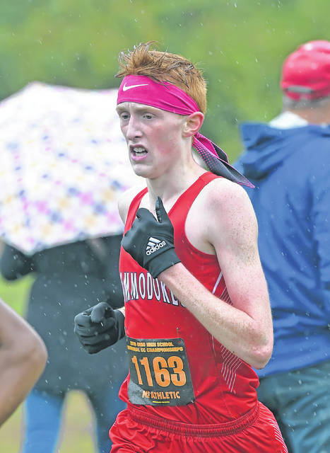 Perry's Brady Yingst competes in Saturday's Division III regional Cross Country Championships at Hedges-Boyer Park in Tiffin. Richard Parrish | The Lima News