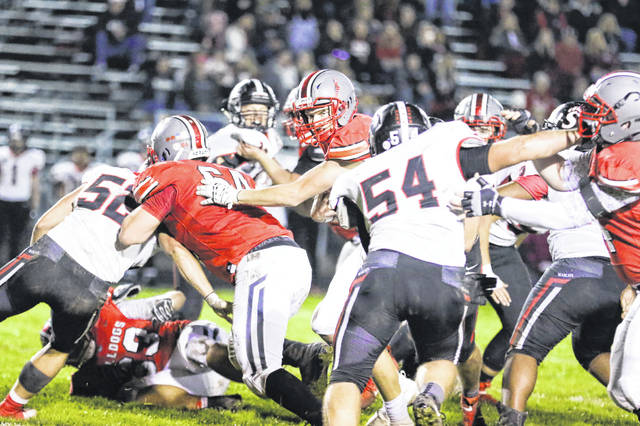 Columbus Grove's Blake Reynolds fights for yardage during Friday night's home game against Spencerville.