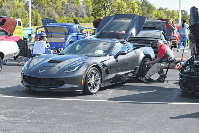 Marty McCaslin, a veteran from Lima, gets his 2017 Corvette show-ready at the Veterans Car Show on Saturday afternoon at Reineke Ford Lincoln in Lima.