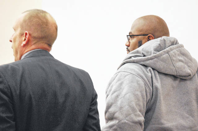 Anthony Davenport, right, is pictured with his attorney, Kenneth Rexford, during Davenport's jury trial in Allen County Common Pleas Court on Wednesday. Testimony in the trial resumes on Thursday.