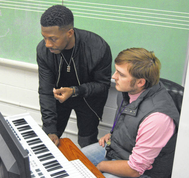 Producer Kendall Nesbitt and student Evan Burden discuss music production at Bluffton University's new digital music lab.