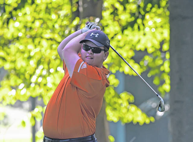 Elida's Ethan Harmon watches his tee shot on the 14th hole during Thursday's Division I District at Sycamore Springs Golf Course.