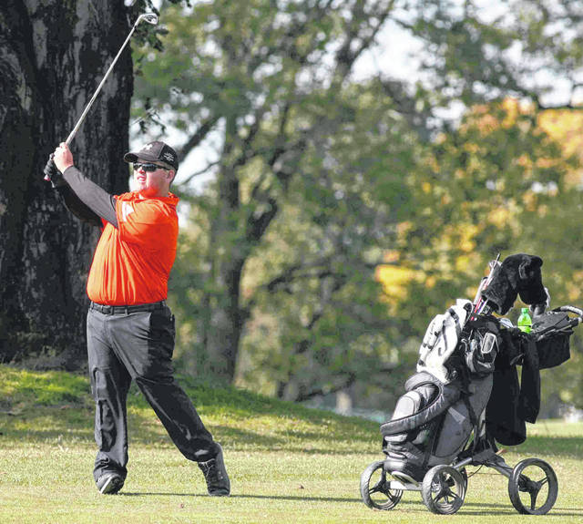 Elida's Ethan Harmon stares down his iron shot on No. 13 during the Division I state tournament Saturday at The Ohio State University Scarlet Golf Course.