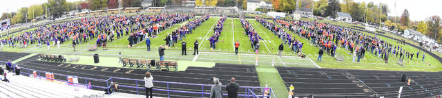 The official toss at Ada schools as a crowd attempts the Guinness World Record for the most people throwing a football simultaneously. See more photos at limaohio.com.