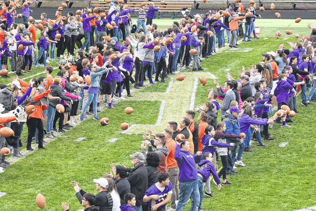People participate in a practice toss Friday afternoon.