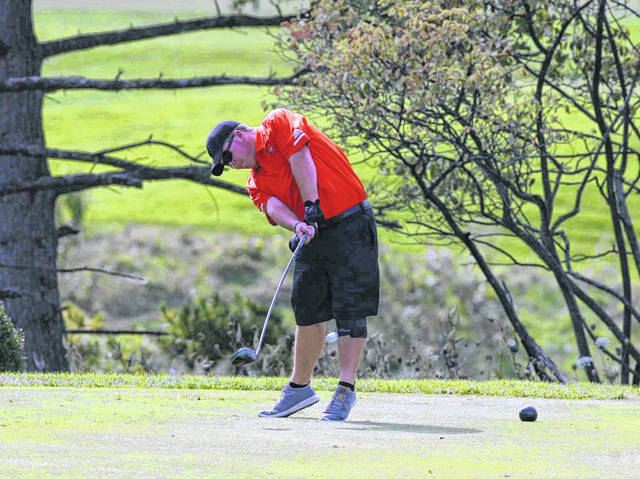 Elida's Gavin Harmon hits his drive on No. 14 during the Division I state tournament Saturday at The Ohio State University Scarlet Golf Course. Jose Nogueras | The Lima News