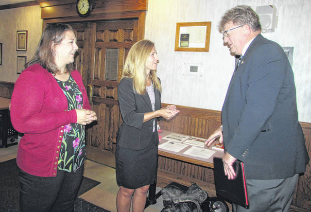 From left are Becky Fruchey, Ottawa Area Chamber of Commerce executive director, and Kelly Theisen, chamber administrative assistant, greeting State Representative Jim Hoops.